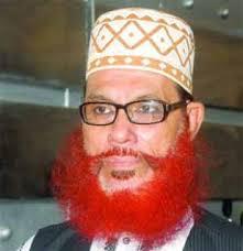 Nå dømt til døden, men velkommen i britisk moske, og ansett som en inspirasjonsskikkelse for mang en britisk muslim med opphav i Bangladesh.
